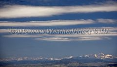Lee Waves Lenticular clouds indicate the crests of rising air in these lee waves.