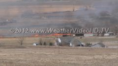 Homes Threatened A fast moving wildfire tears across dry grassland and threatens home and ranches during Red Flag Warning conditions near Wellington, CO, spring, 2012