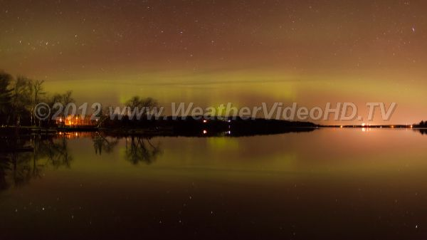 Night Lights, Nights Sounds The aurora swirls over a lake in spring as loons cry out.