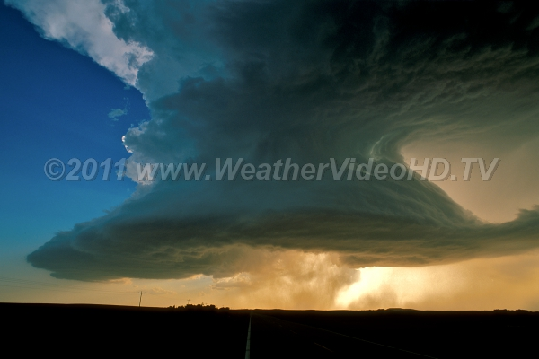 Super Supercell A massive, rotating low-precipitation supercell backlit by the evening sun over the South Dakota plains