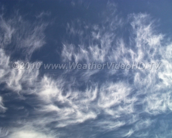 Hooked Hook-like cirrus uncinus due to ice crystals falling through wind shear