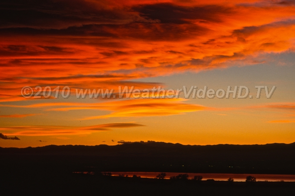 Deep Orange Sunset creates deep orange cloudscapes in wave clouds in the western U.S.