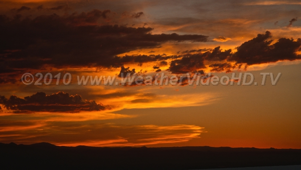 End of a Perfect Day Sunset creates deep orange cloudscapes in wave clouds in the western U.S.