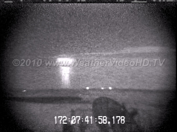 Distant Sprite Sprite above thunderstorm  at 800 km range appears to emerging from horizon