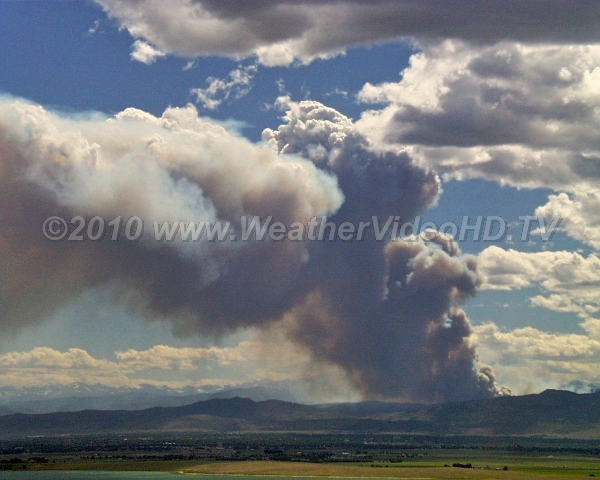 Fire Cloud Cumulus cloud forms in plume of smoke from a large forest fire