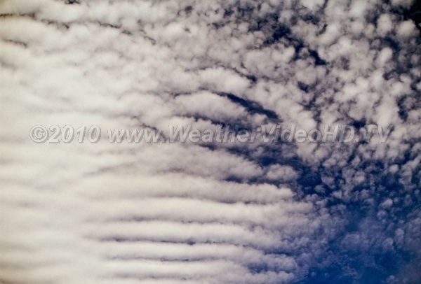 Altocumulus Undulatus Clouds make visible short period gravity waves which move within elevated inversions
