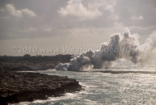 Lava Meets Ocean Plume of steam and salt particles blow off from meeting point of lava and sea
