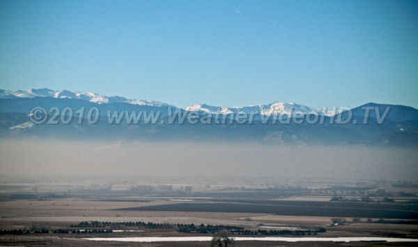 Dirty Air Intense low-level inversion traps pollutants in a shallow layer along the Front Range