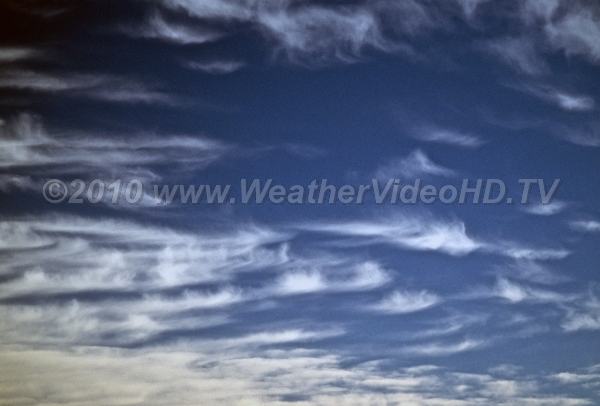Icy Feathers Cirrus uncinus produce long streaks of falling ice crystals near the tropopause