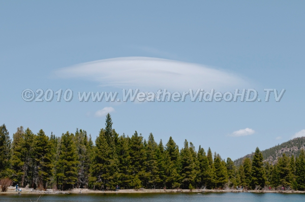 Whispy Wave A gossamer lenticular cloud over a mountain lake