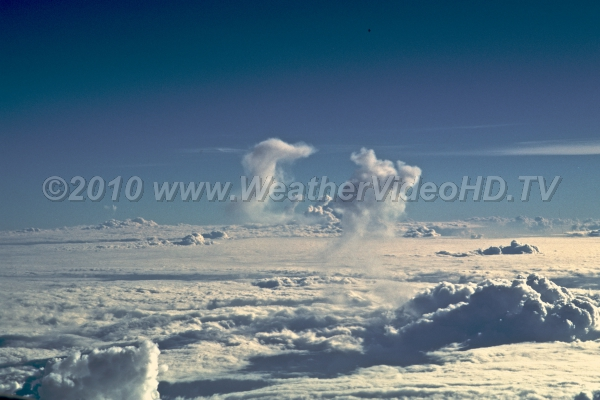 Dissipating Anvils Several anvils remain from convective towers which punched through the undercast