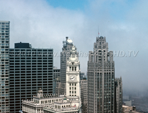 Loop Fog Dense fog rolls into the Chicago Loop on a spring lake breeze