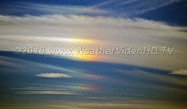 Solar Canine aka Sun Dog, this optical display indicates hexagonl ice crystals in the clouds