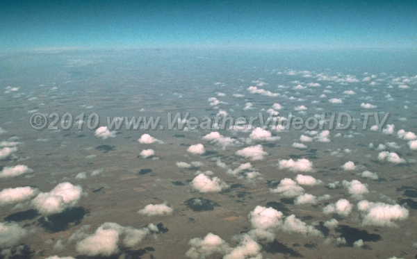 Puffy Clouds Cumulus dot the plains as the sun warms the ground cuasing thermals to rise