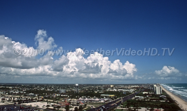 Sea Breeze Front Cumulus begin to tower on the sea breeze front on FLorida