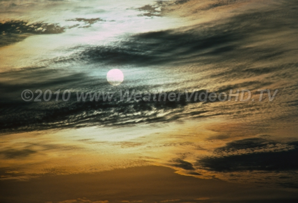 Silver Sun Solar disk seen though ripples of altocumulus