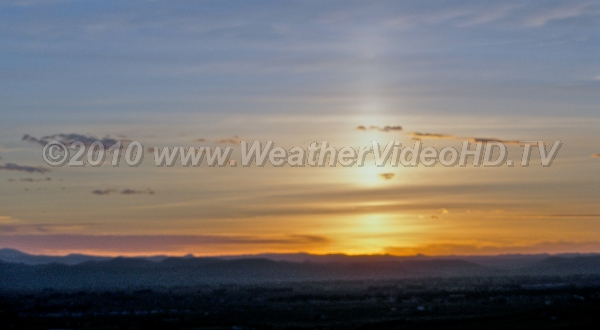 Sun PIllar Pillar of light rsing from the sun already set below the western horizon  with the aid of high ice crystals