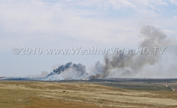 Wildfire! Plume of smoke from a prairie wildfire loops in an very unstable atmosphere