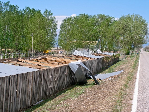 Ripped Roofs Downburst winds of 55-65 mph peeled back roofs of farm sheds