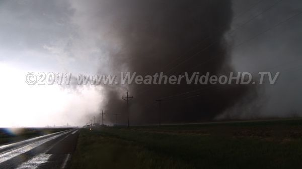 Crossing the Highway Tornado approaches a highway while chasers watch, hail bounces off car