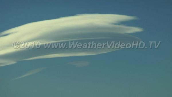 Pie Plates Stacked lenticular clouds in wave crest