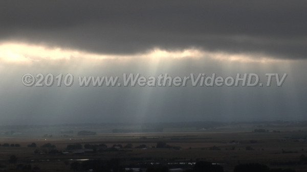 """Sun Drawing Water"" Crepuscular rays shine through a broken cloud layer"