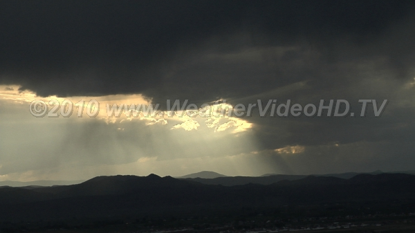 High Base Thunderstorm Virga and rain fall from developing storm wth base above ~8000 ft AGL