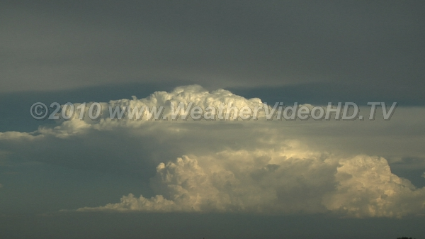 Storms Intensifying Strong updrafts can be seen feeding a distant, developing thunderstorm complex