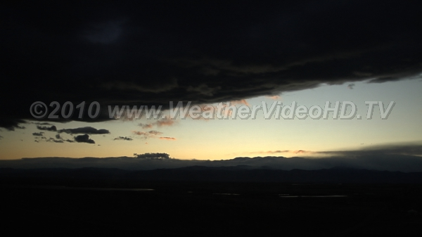 Twilight Sky The darkening western sky framed by mountains and the clouds they spawned