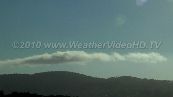 Fractostratus Fractostratus, or scud, stream over the coastal highlands on the California coast
