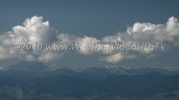 Mountain Cumulus Sunshine on warm early autumn days causes thermals to rise and cumulus to form