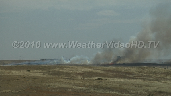 Wild Fire Hot, dry summer winds fan grass fire which sweeps over several farmsteads