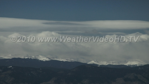 Mountain Snows Snow falls from cap clouds being forced over high peaks
