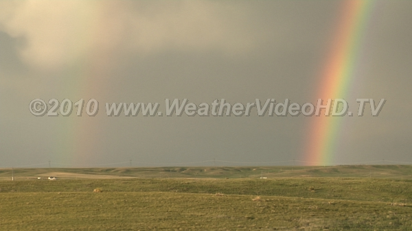 Double Rainbow Rain falling from departing shower illuminated by sun