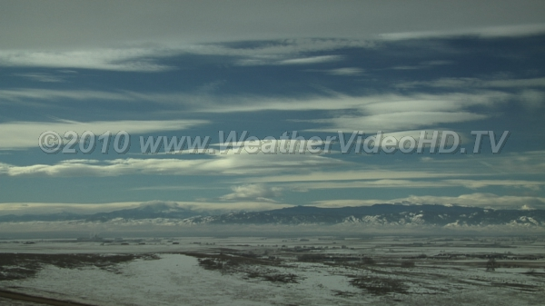 Cold Winter Day in the Mountains Strong jet stream aloft, mountain waves, and pollution trapped near ground
