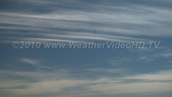 Cirrus and Contrails Watch as jet contrail expands and grows in moist upper atmosphere.