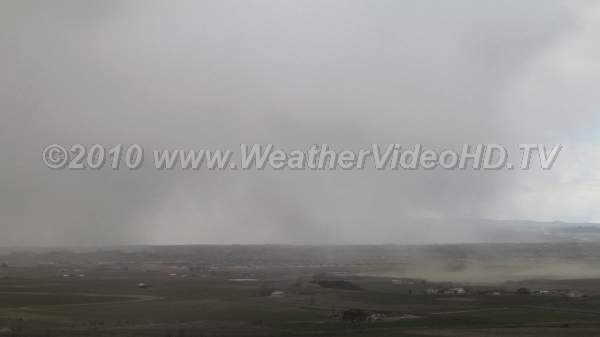 Dusty Microburst Dry microburst picks up huge clouds of loose soil and dust