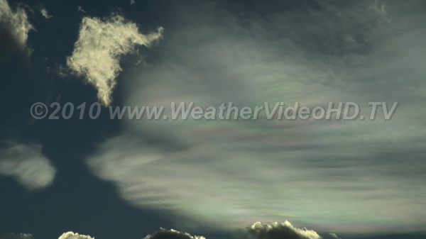 Wavy Mother-of-Pearl Iridescence in mountain wave clouds