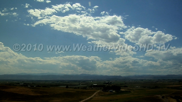 Peaceful Mountain Clouds Shallow convective clouds over mountains dissipate as they move into the plains