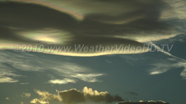 Zoom Into Wave An iridescent-edge lenticular cloud at sunset