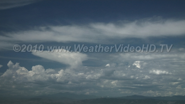 Anvils Mountain rainstorms first start by moistening the middle atmosphere with small anvils