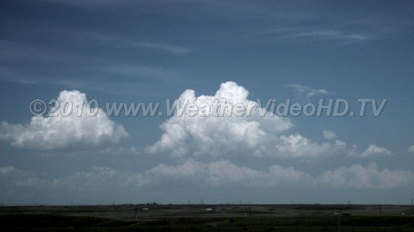 Disturbed Sky Convective clouds develop and rain showers commence with daytime heating
