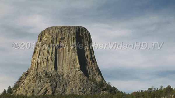 Cirrus and Cirrostratus High icy crystal clouds stream above the Devils Tower, a Wyoming landmark