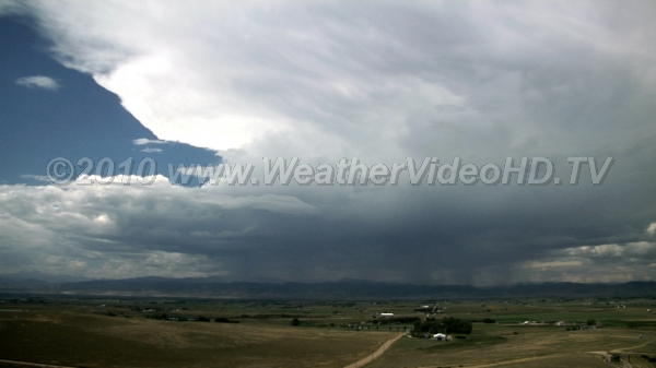 Supercell Rotating supercell moves off mountains followed by more storms