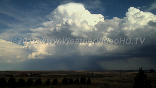 Distant Microbursts Intense storm updrafts veiled by pileus with microbursts emerging from base of storms