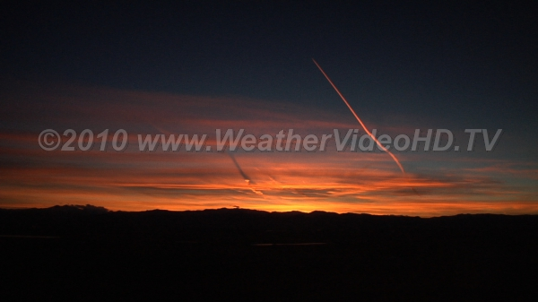 In the Red A sky with a lot of contrails plus natural cirrus gets painted red at sunset