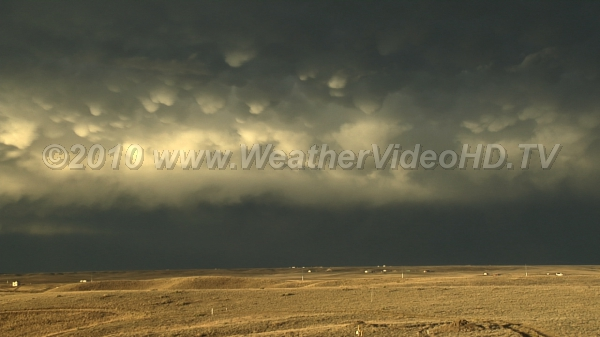 Mammatus and Rainbow Falling precipitation from rear of thunderstorm complex produces effects