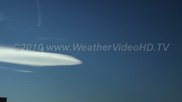 Altocumulus Lenticularis with Contrails Mountain wave clouds