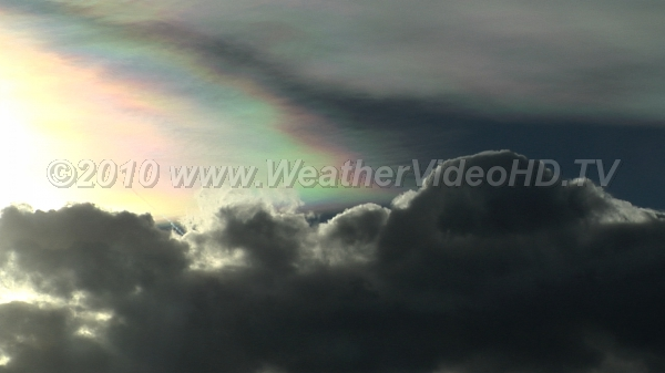 Color Clouds Iridescence in wave cloud atop a mountain wave rotor