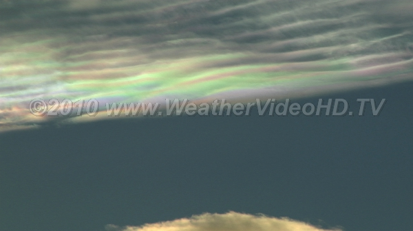 Iridescent Waves Iridescence in altocumulus lenticularis clouds and ripples